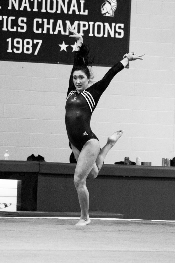 Warrior Veronica Peterson completes her floor routine on Feb. 18 in Winona.  KYLIE BRIDENHAGEN