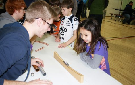 A girl from Madison's Elementary School is very curious about how a gravity wheel works at the Physics Fun Night, a night filled with science and experiments. Photo: Sara Tiradossi
