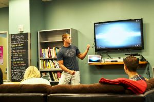 """Spencer Treu presents """"7 Habits of Highly Successful Students"""" at the IWC for the first Wellness Wednesday. (Photo by Kelsey Cherwinka)"""