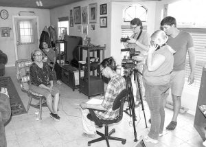 Winona State University and Diné College students interview and film Navajo Elder Peggy Scott during the 2015 Navajo Oral History Project.