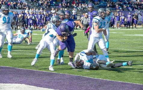 Paul Preston rushes into the end zone for the touchdown against Upper Iowa Saturday in Winona. (Photo by Jacob Striker)