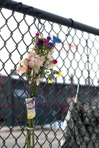 A small memorial has been established at the Huff Street train track crossing for Derek Brute with flowers and his jacket. Bute was killed when he was struck by a train early morning Sunday, Jan. 17. (Photo by Jacob Striker)