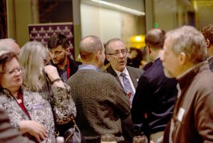 Winona State's new vice president Ron Dempsey mingles with community members and Winona State faculty at the advancement reception Thursday, Jan. 28 at the Winona Historical Society. (Photo by Jacob Striker)