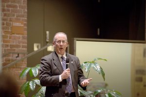 Winona State's new vice president of advancement and executive director of the Winona State Foundation, Ron Dempsey, speaks at his advancement reception Thursday, Jan. 28. (Photo by Jacob Striker)