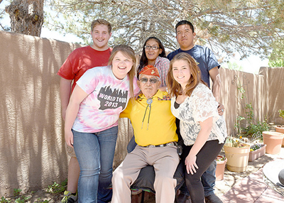 Students from Diné College and Winona State gather together for a group picture after their final interview with Navajo Code Talker Bill Toledo for the Navajo Oral History Project. (Contributed photo)