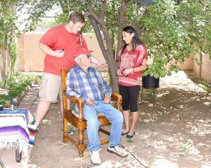 Winona State senior Jacob Hilsabeck and Diné College student Stephanie Tsosie prepare to interview World War II Code Talker Bill Toledo the last year of the Navajo Oral History project. (Contributed photo)