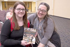 """Junior MaKayla Culpitt had indigenous writer Heid E. Erdrich sign her newest published work """"Original Local: Indigenous Foods, Stories and Recipes from the Upper Midwest"""" for her after Erdrich's speech on Wednesday, April 6. (Photo by Taylor Nyman)"""