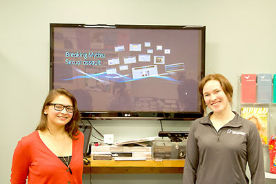 Health and wellness student advocates Mary Molstad (left) and Carissa Balow (right) host a presentation on  gender-based violence and its myths Monday, April 4. (Photo by Sara Tiradossi)