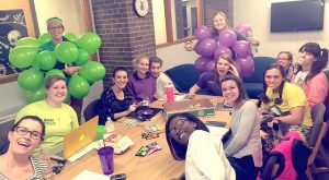 Sophomore Mary Sullivan and fellow Sheehan Hall RAs dressed up for an event. Sullivan is pictured in the green balloon suit. (Contributed photo)
