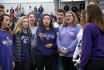 Winona State's acapella group Hear and Now sings the National Anthem before the football game Saturday.