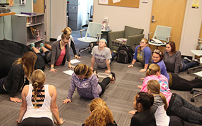 Students learn new stretches at 'Yoga for Newbies'