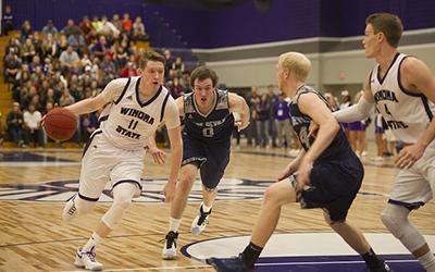 Men's basketball opens season with win