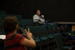 """Senior student director Casey Howe (left) talks with senior stage manager Kort Lindblad (right) about a stage direction for the reading of """"Morning, Noon & Night."""" Lindblad wrote his own senior capstone project and it will be performed Dec. 2-3. (Photo by Taylor Nyman)"""