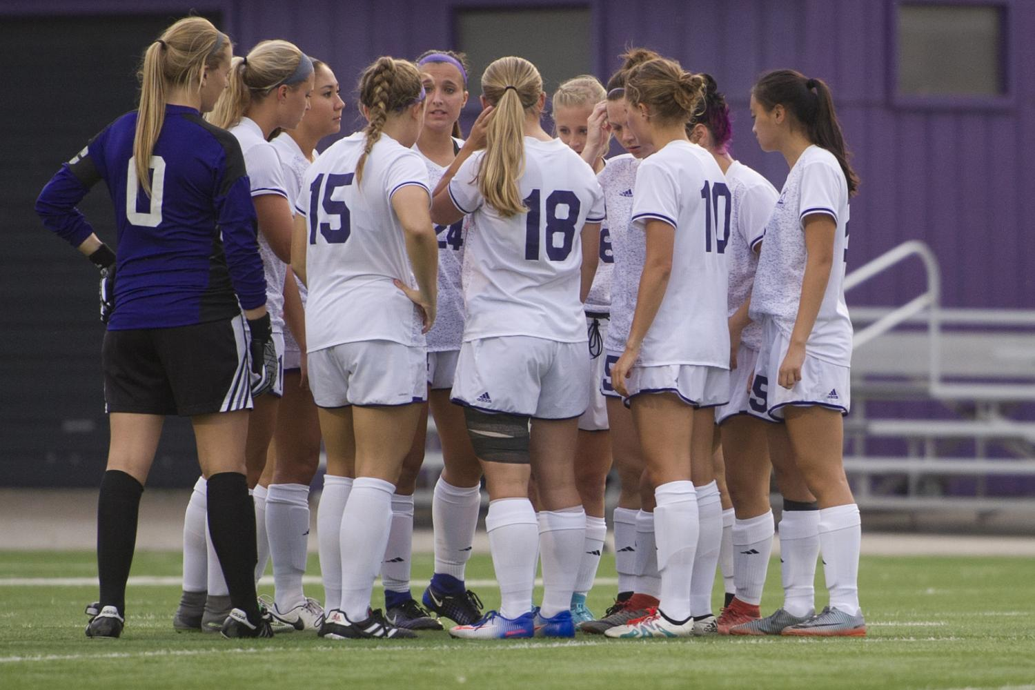 Members of the Winona State soccer team gather for a group huddle at a game against Upper Iowa on Thursday, Sept. 9. The team played two games this week, winning 4-0 against Wayne State College on Friday.