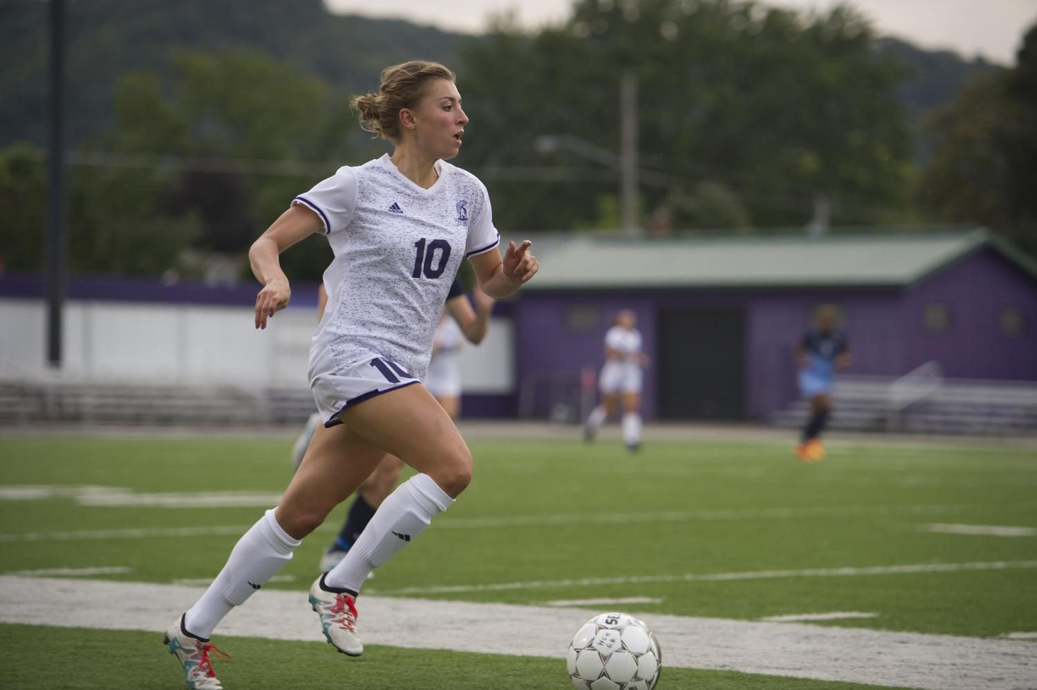 Junior Addie Royer kicks the ball up the field during Thursday night's game against Upper Iowa University. The Warriors tied with Upper Iowa 0-0.