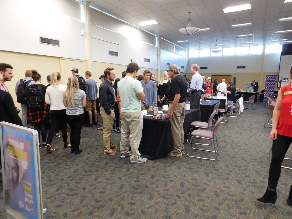 Students discuss future career options with a businessman during the WarriorsINNOVATE Challenge event on Thursday, Sept. 28 in East Hall. Professionals from companies such as WinCraft and Fastenal serve as judges for this year's competition.