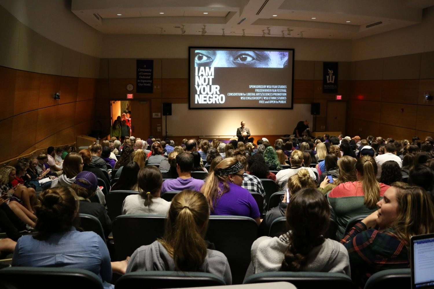 "Despite a seating shortage students continued to file into the SLC Auditorium Wednesday for the screening of ""I Am Not Your Negro""."