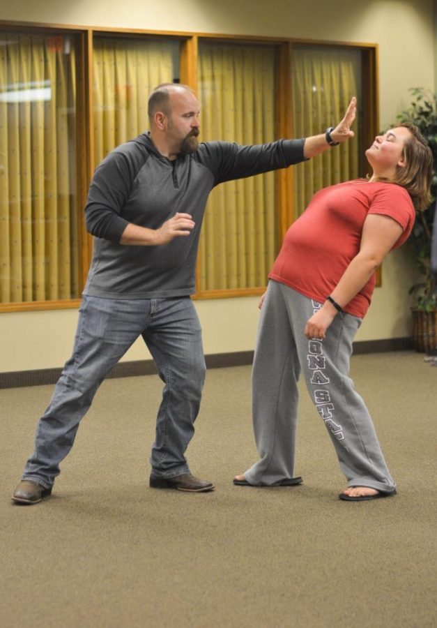 Left to right: Deputy John Hazelton and Freshman Kateyln Nutt demonstrate a counterattack move during Housing and Residence Life's self-defense class last Thursday, Oct. 5.