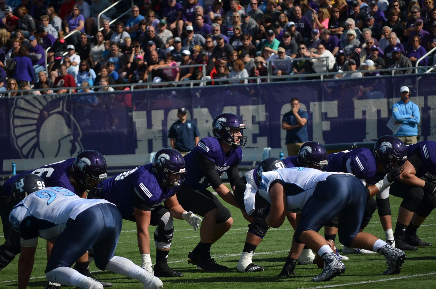Winona State football players get ready to start a play at their game against Upper Iowa University on Sept. 30. The Warriors swept the game winning 37-7.