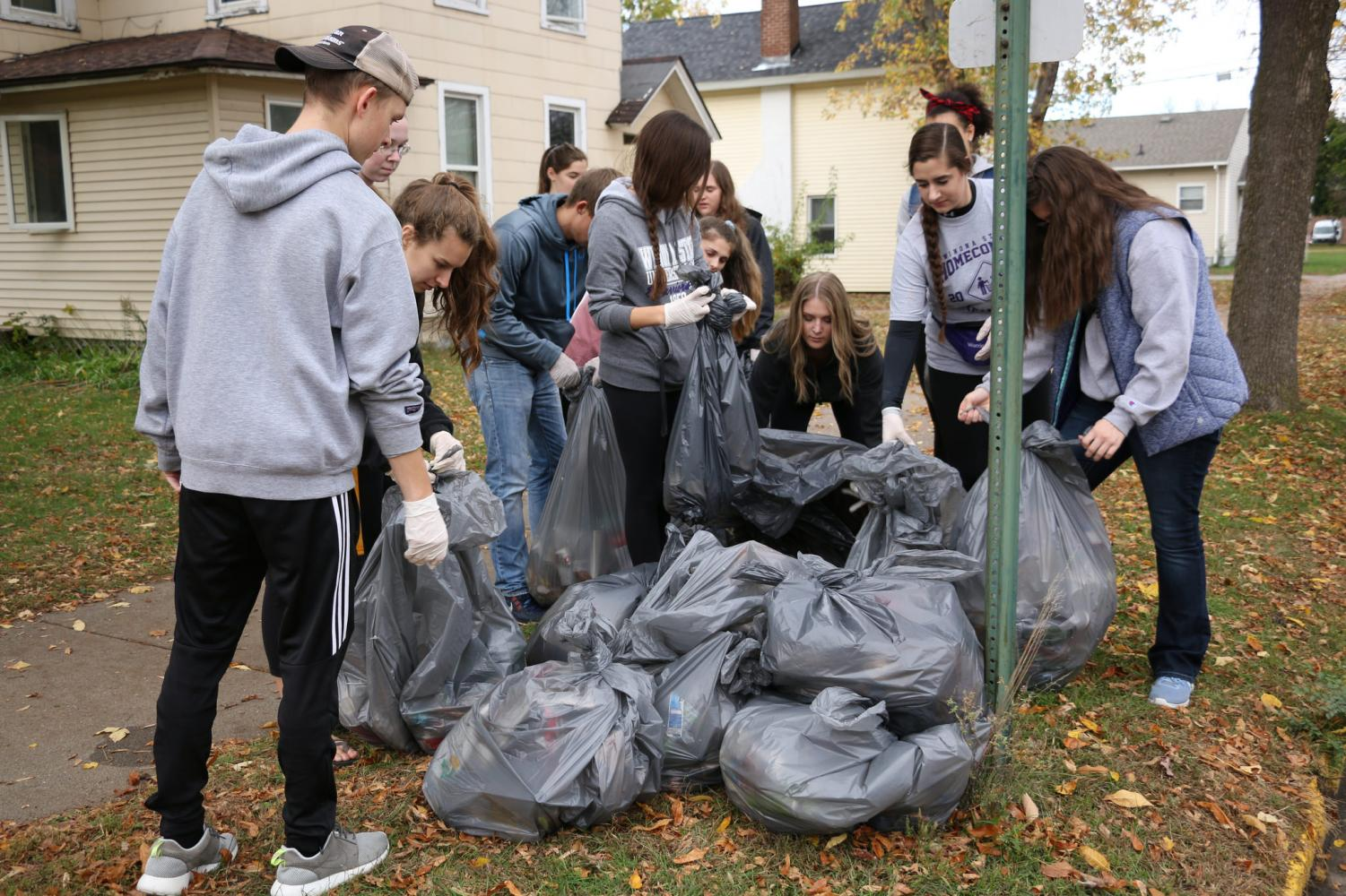 Student volunteers dropped off trash bags for pick-up following the Homecoming Weekend Clean Sweep on Sunday, Oct. 22.