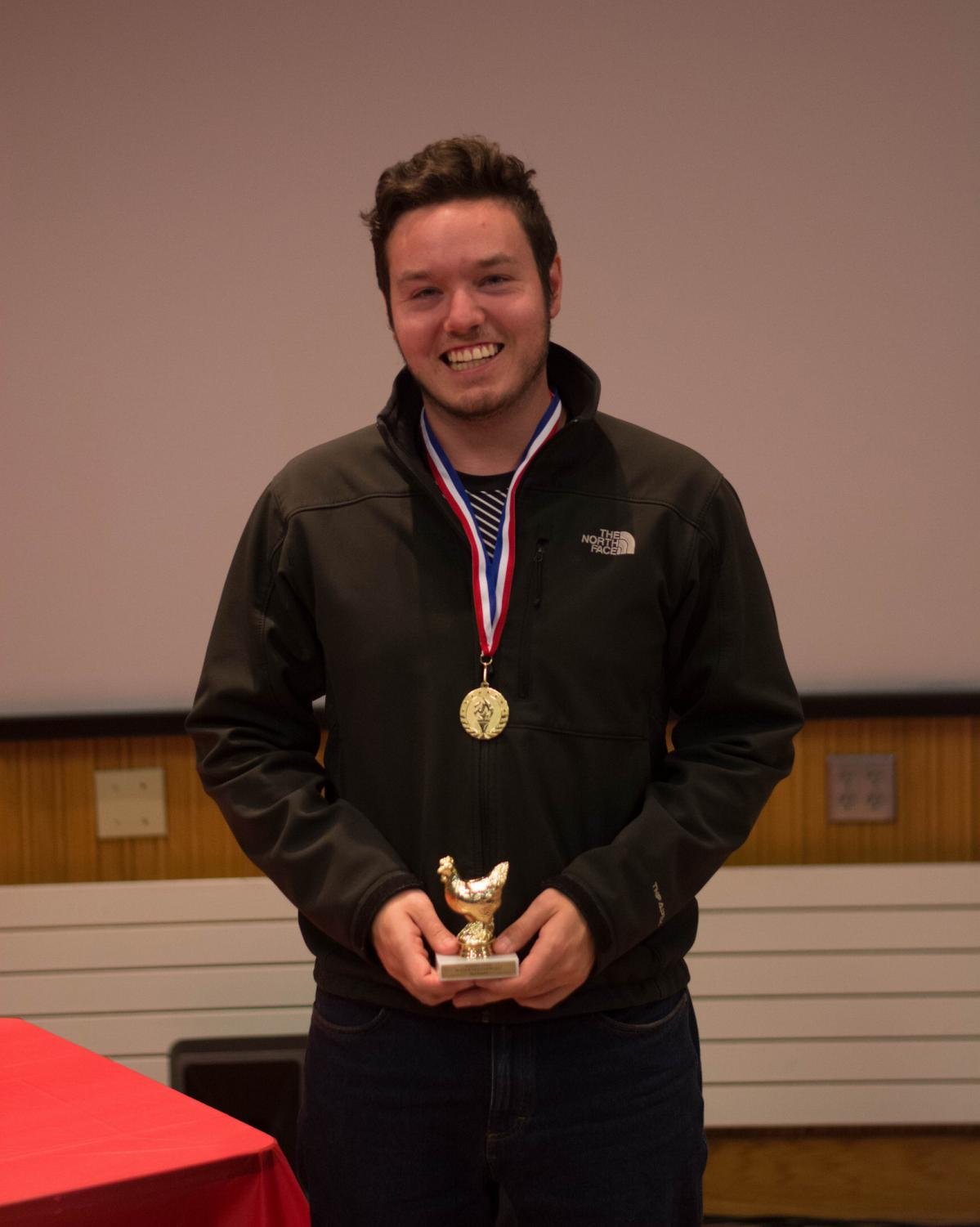 "Senior Caleb Hammel, smiles after winning ""The Reginald"" for best editing at the 48-hour Video Dash screening and awards on Tuesday, Oct. 24 in Stark 103."