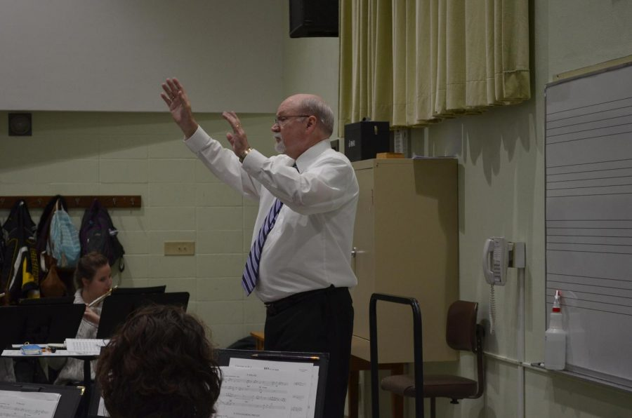 Professor Donald Lovejoy conducts a Symphonic Wind Ensemble rehearsal on Friday, Oct. 27 in PAC 156. Lovejoy has been the director of bands and coordinator for brass studies at Winona State for 17 years.