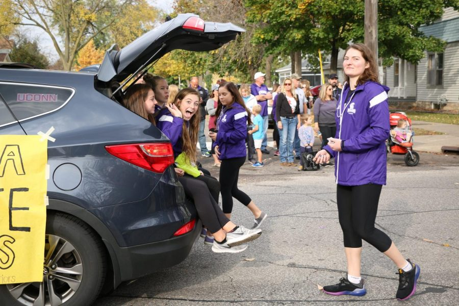 The Winona State Tennis team members waved to the crowd as they sat in and walked behind the back of a car during the Winona State University Homecoming parade.  Other Winona State students and alumni marched through the streets of Winona passing out candy and other prizes while waving and showing off their float decorating skills. Some Winona State clubs and organizations included Greek organizations like Sigma Tau Gamma and Alpha Sigma Tau, sports teams like the Winona State football team and the Winona State dance team and hall of fame inductees.
