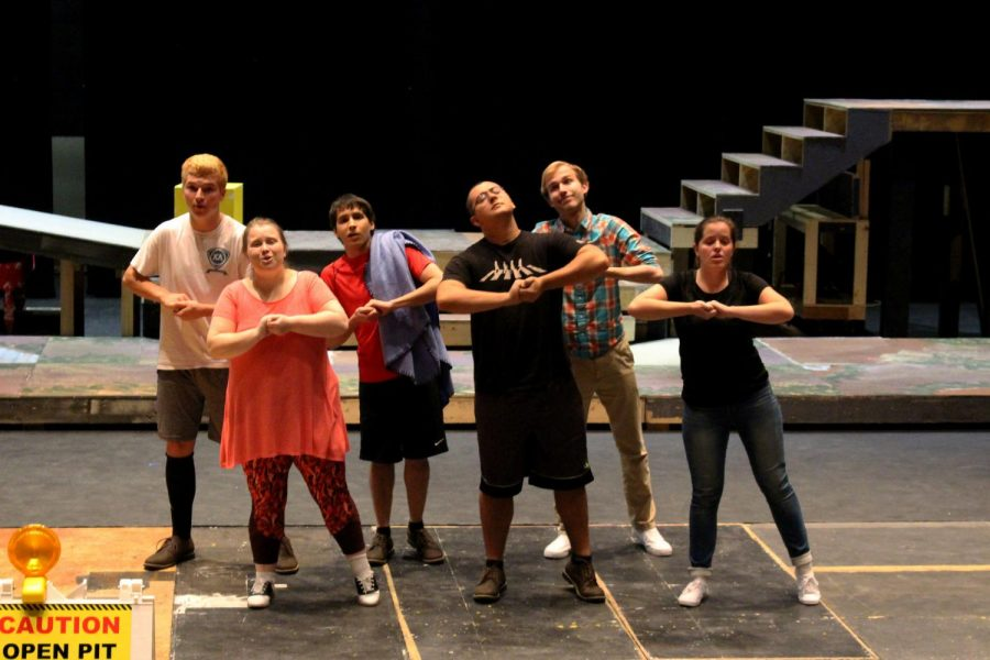 """Left to right: Andrew Elmquist (Schroeder), Kayla Williams-Schwarze (Lucy), Lance Urbick (Linus), Elijah Wood (Charlie Brown), Noah Schomburg (Snoopy), Janelle Johnson (Sally) perform a scene at rehearsals last Monday for the musical """"You're A Good Man, Charlie Brown"""" on the Vivian Fusillo main stage."""