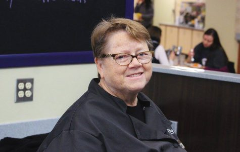 Sandy Rothering sits at the cash register of the Jack Kane Dining Center in Kryzsko Commons. Rothering has worked at Winona State since 2001, and has been working the Jack Kane cash register for the past nine years.