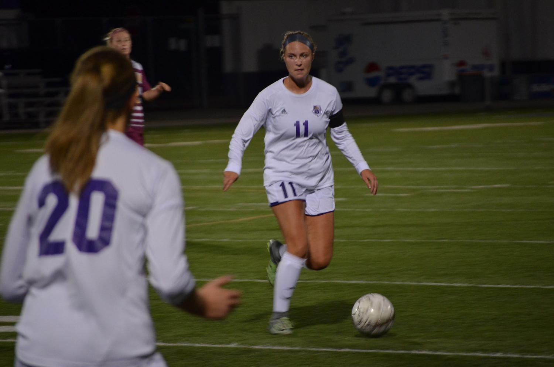 Senior Mikaella Sabinash looks to pass the ball on Friday, Sept. 29 at Altra Federal Credit Union Stadium against University of Minnesota Duluth.