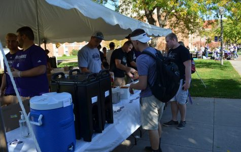 Members of the Winona State football team hands out walking tacos at the club fair on Friday, October 20 in front of Gildemeister Hall.