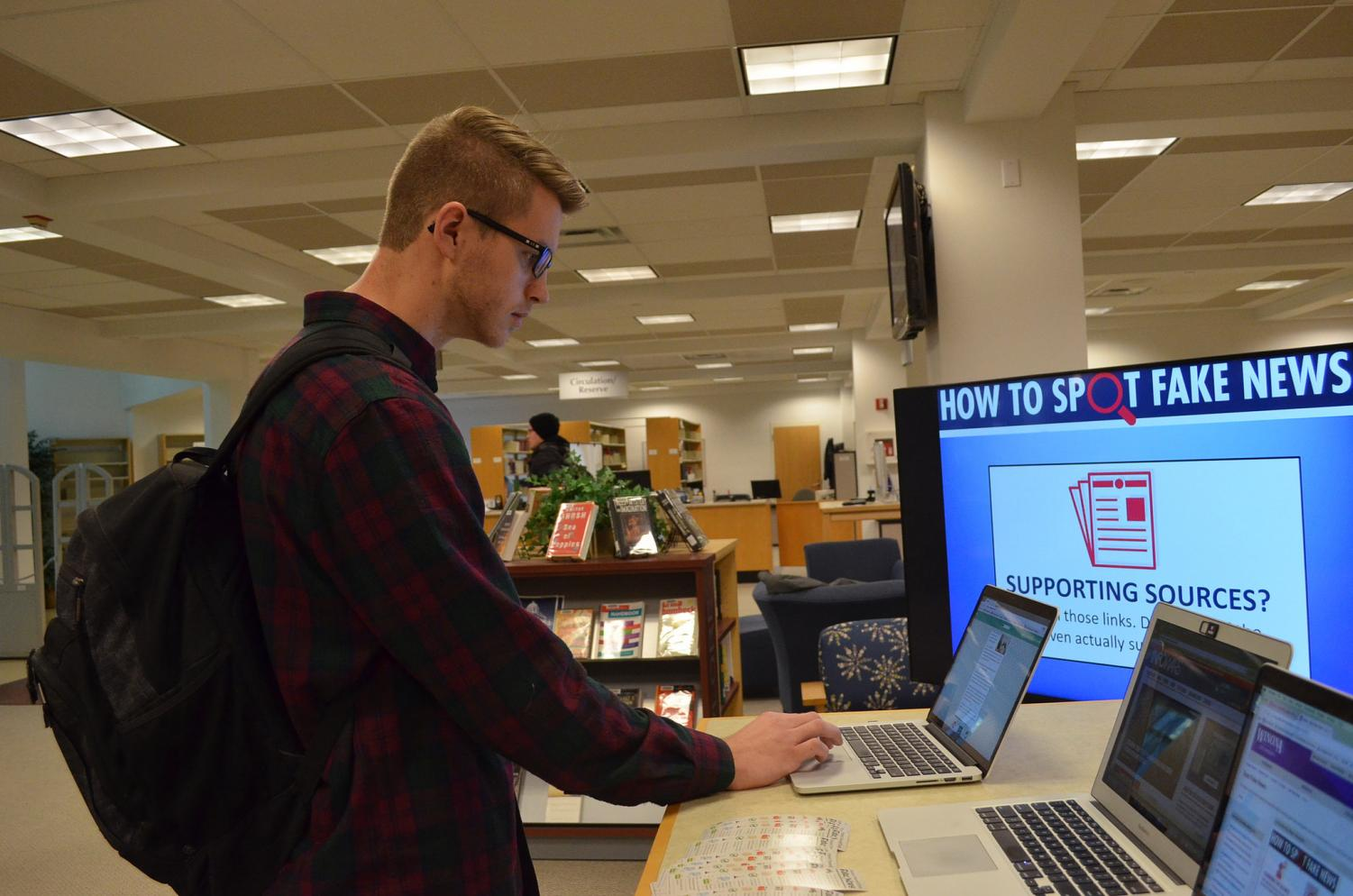"Fifth-year public relations major Sam Wareham participates in a quiz testing his knowledge on how to spot fake news during Tech Tuesday's ""How To Spot Fake News"" in the library on Tuesday, Nov. 21. Faculty guided participants navigate which news sites were credible with the help of slide shows and a final quiz."