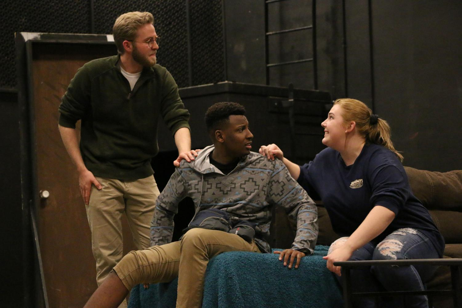 "From left to right, senior Jake Leif, first-year Ian Loretz and first-year Jessica Campbell rehearse a scene from the theatre and dance department's upcoming production, ""A Dog's House."""