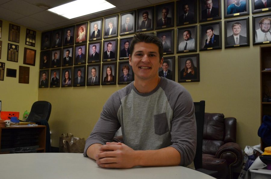 Senior student senator Carter McCauley sits in the senate office, he is one of the college of science representatives and the interim chair for student services.