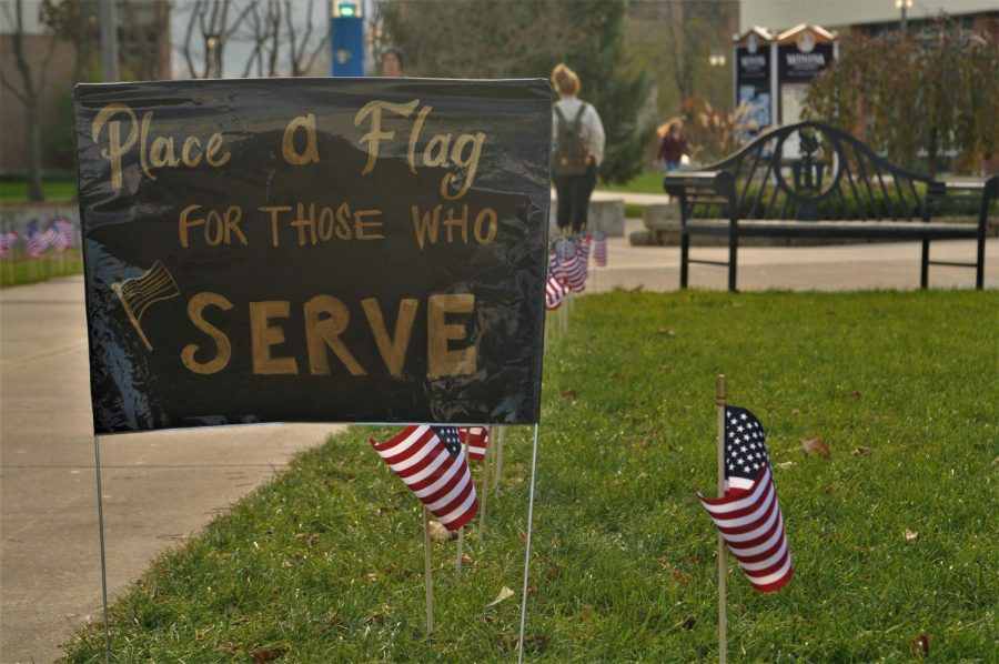 """Flags lined the grass outside Kryzsko Commons last week for the """"Salute to Service"""" events sponsored by the veterans club in honor of students and community members who have served in the armed forces."""