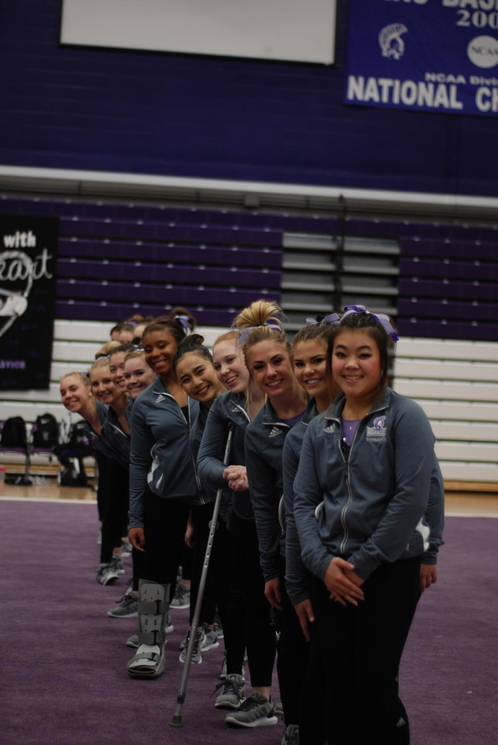 The Winona State Gymnastics Team lines up at the start of a dual meet against Hamline University and the University of Wisconsin Whitewater last Friday in McCown Gymnasium. This meet was also senior night where the team honored seniors Eboni Jackson, Katie Pipp, Gianna Scala, Katie Carling and Emily Woitchek.