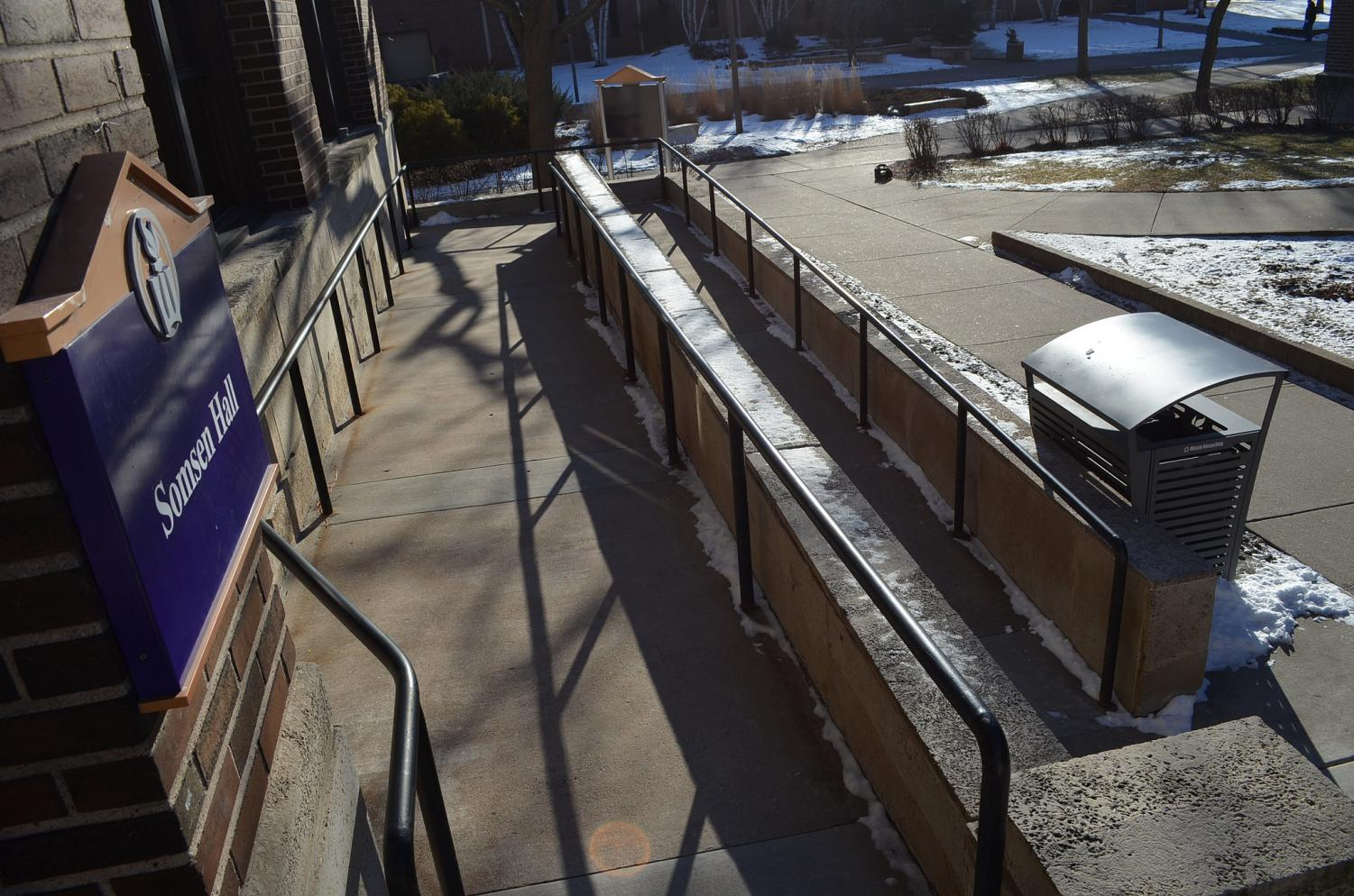 The ramp outside of Somsen Hall is used by many who are unable to use the stairs. While it is a good addition, turning corners can be tricky for many using wheelchairs or scooters and like many of the access services on campus could use improvements.