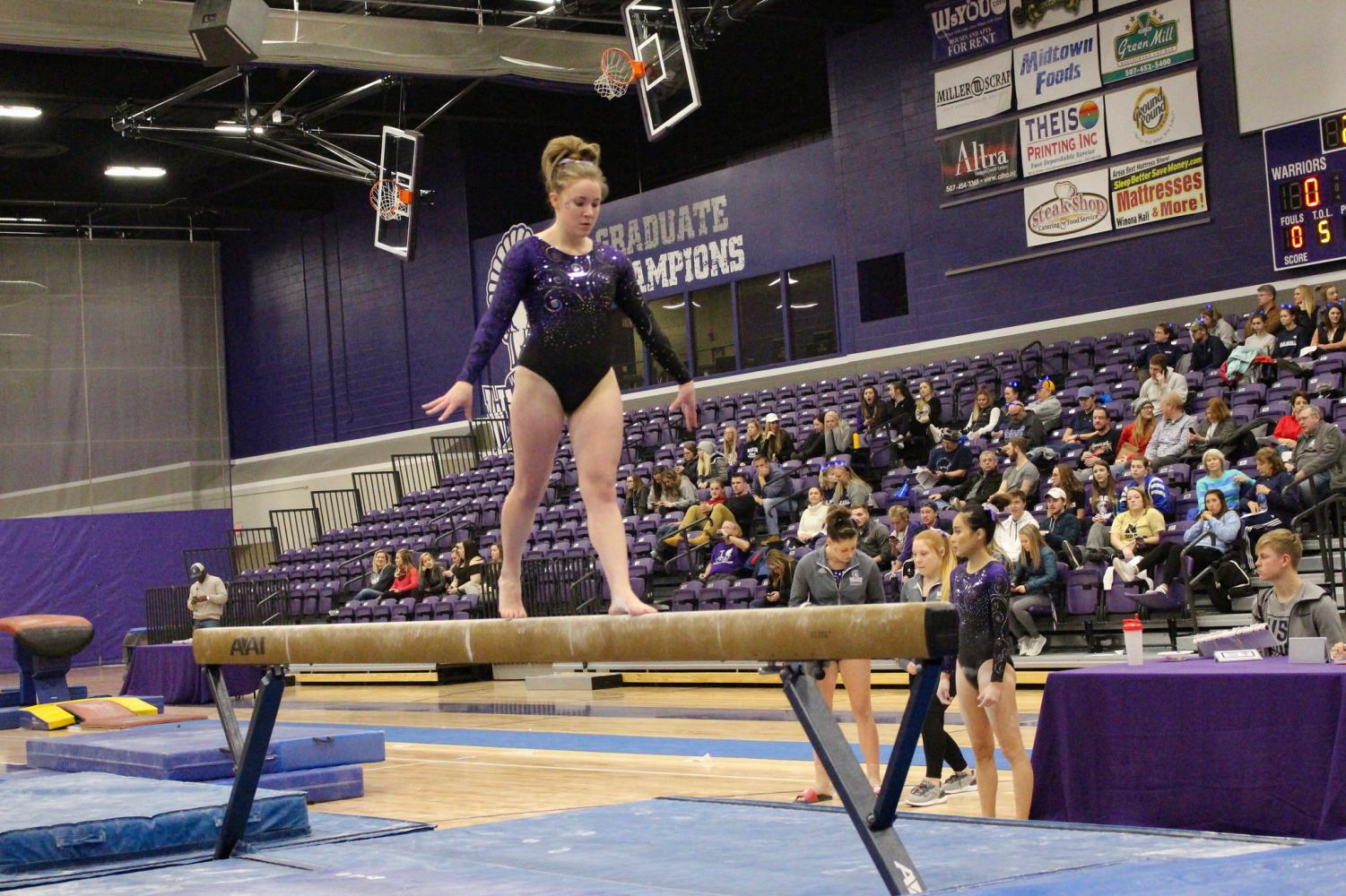 Junior Miranda Saathoff completes a routine on the balance beam in a meets against the University of Wisconsin Stout on Tuesday, Jan 9 in McCowan Gymnasium.