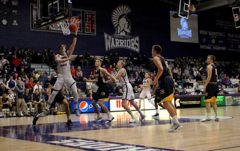Basketball finishes away streak on top