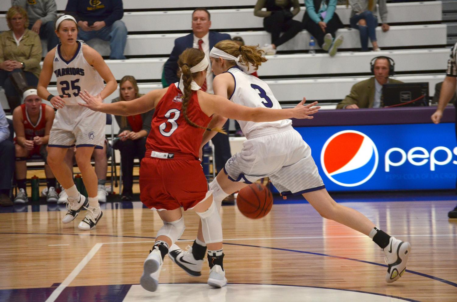 Junior guard Liz Evenocheck surges towards the basket at an exhibition game against the University of St. Mary's in McCown Gymnasium on Saturday, Nov. 4.
