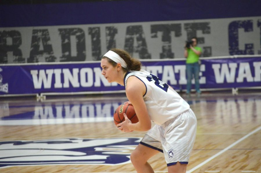 Junior guard Kayla Schaefer looks to pass the ball too a teammate at an exhibition game against the University of St. Mary's on Saturday, Nov. 4 in McCown Gymnasium.