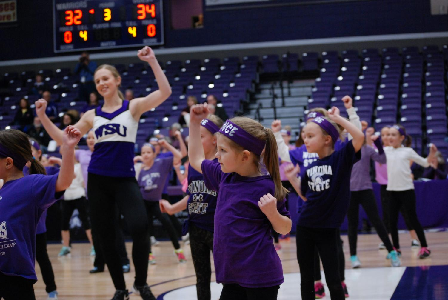 Members of the kid's dance clinic perform alongside the Winona State University Dance Team during halftime of the Winona State women's basketball game on Saturday, Feb. 3 in McCown Gymnasium.