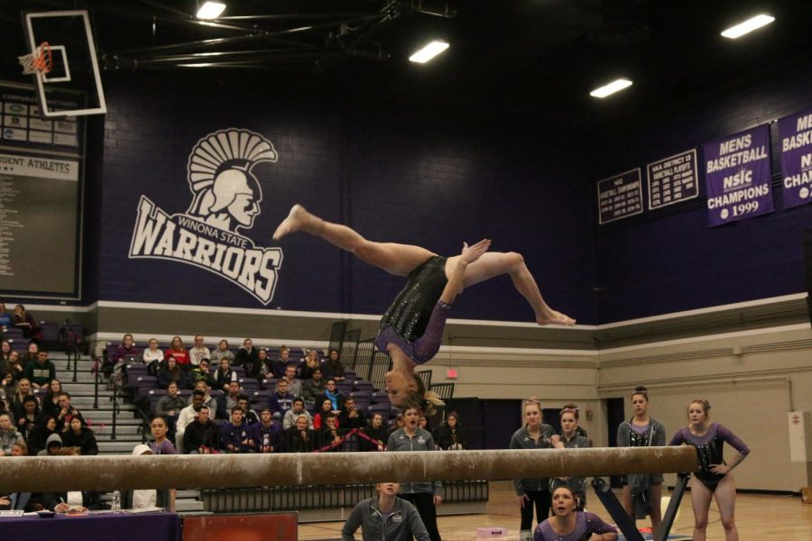 Senior+Katie+Carling+completes+her+beam+routine+at+a+meet+against+the+University+of+Wisconsin-Eau+Claire+on+Thursday%2C+Feb.+15+in+McCown+Gymnasium.+Carling+placed+second+in+beam+with+a+score+of+8.975+and+the+Warriors+won+183.325-182.125+in+the+last+home+meet+of+the+regular+season.