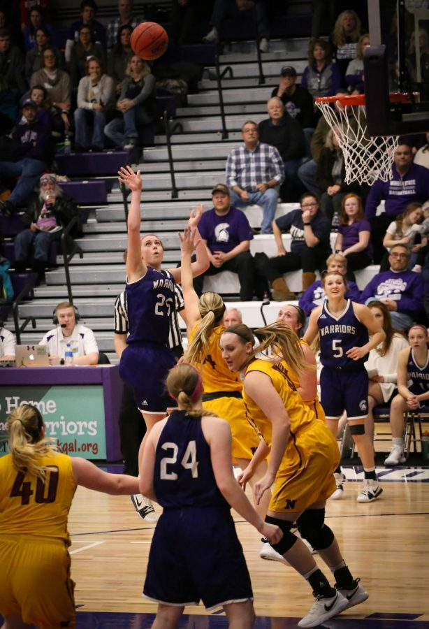 Junior guard Kayla Schaefer floats a two-pointer to tie Saturday night's game in the third quarter against the Northern State Wolves in McCown Gymnasium.