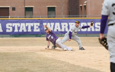 First year infielder Zac Stange makes an attempt for second base in a double header against Sioux Falls University on Friday, March 23 in Loughrey Field, the Warriors won both games against the Cougars 5-1 and 4-3.
