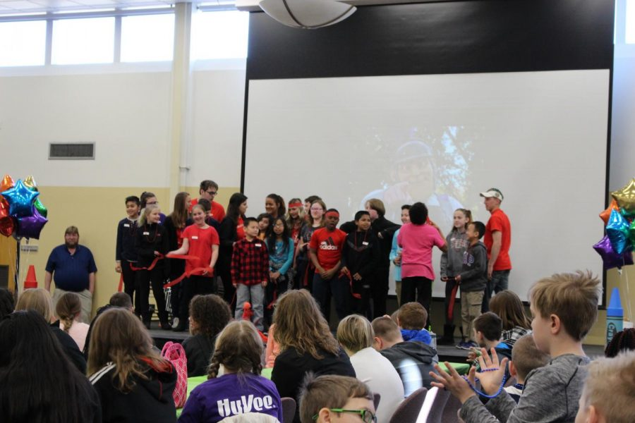 """The Red Team shares their team cheer in East Hall during the """"March 2 Campus"""" event held on Thursday, March 22 for fifth graders in the Winona area to tour Winona State's campus and participate in activities that help teach about college experiences."""