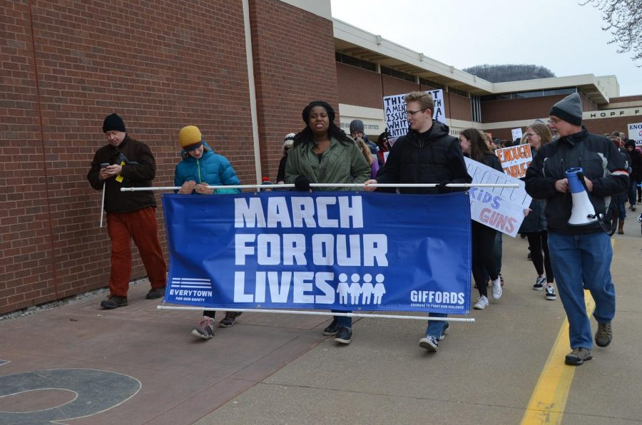 Student activists lead the way from Winona Senior High School on Saturday, March 24, kickstarting Winona's March For Our Lives protest. Between 400-500 people of all ages came together to march for more comprehensive gun laws in the wake of the Parkland shooting.
