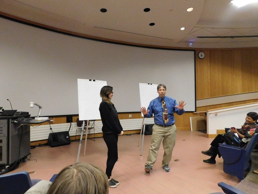"""""""Mathemagician"""" Arthur Benjamin gave demonstrations of his """"math magic"""" on Thursday, March 15 in SLC 103. Benjamin performs his opening trick, which uses an invisible deck of cards that then became visible and displays the card that the volunteer imagined."""
