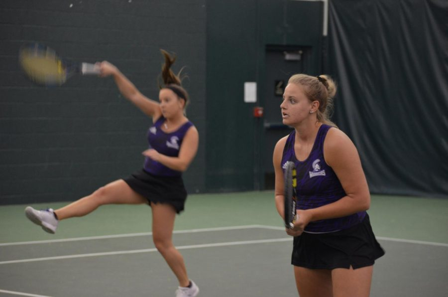 Senior+Justine+Daane+gets+ready+for+the+next+volley+during+a+doubles+match+on+Saturday%2C+March+17+against+Upper+Iowa+University+at+the+Winona+Tennis+Center.+The+Warriors+traveled+to+Sioux+Falls+this+past+weekend+to+face+off+against+the+University+of+Sioux+Falls+and+Augustana+University%2C+winning+one+match+6-3+and+losing+the+other+0-9.