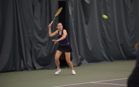 Tennis continues to win at home match
